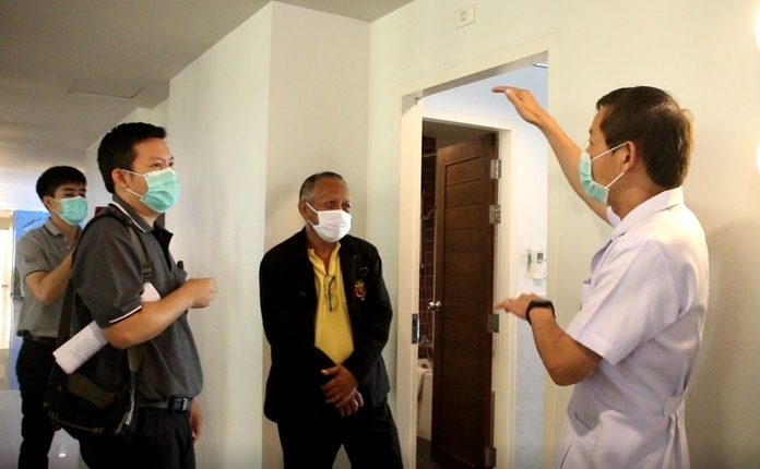 Health Ministry authorities and city officials inspect the Grand Bella Hotel in view of converting the premises into a field hospital for treating COVID-19 patients.