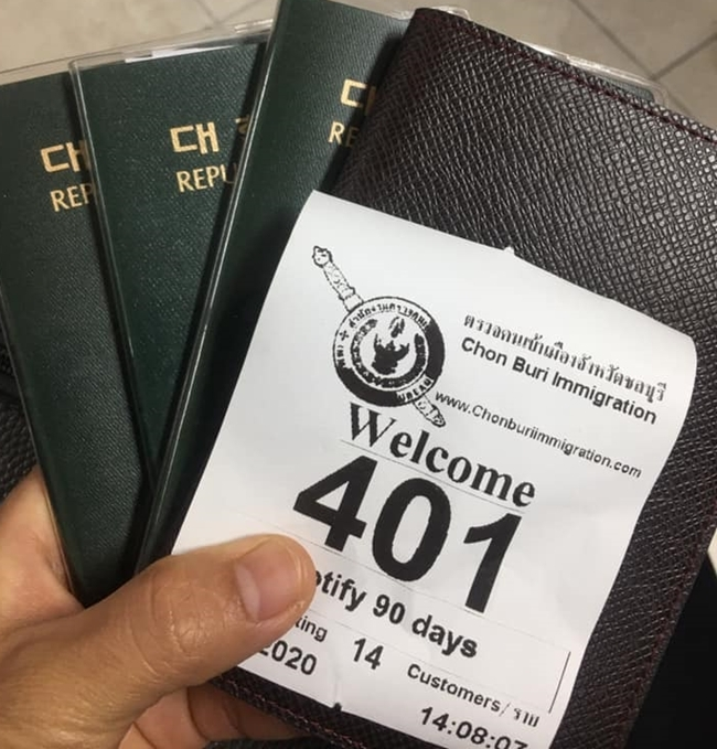 An unidentified messenger with a handful of passports shows the 90-day reporting ticket being handed out.