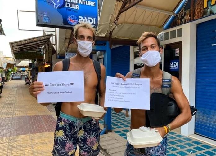 Tourists hold up signs of gratitude for the kindness and care that the receive from the Thai people.