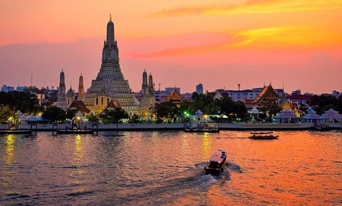 Wat Arun by the Chao Praya River, Bangkok at sunset.