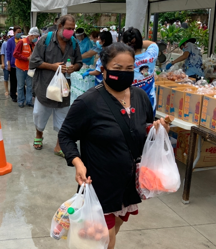 A lady is moved by the generosity of foreigners living in Thailand.