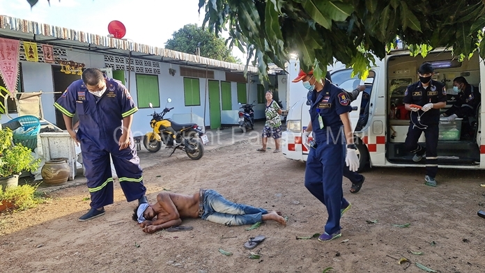 Rescue workers tend to Sompong Deewangyang after a drunken brawl in a construction workers' camp.