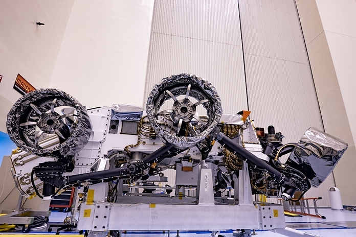 Wheels are installed on NASA's Mars Perseverance rover inside Kennedy Space Center's Payload Hazardous Servicing Facility on March 30, 2020. Perseverance will liftoff aboard a United Launch Alliance Atlas V 541 rocket from Cape Canaveral Air Force Station in July 2020. (Credits: NASA/JPL-Caltech)