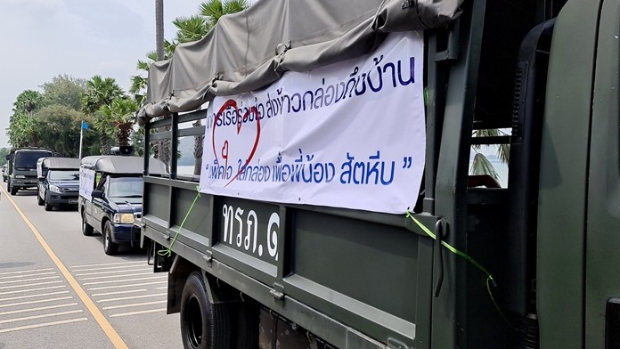 A Royal Thai Navy convoy leaves the navy base loaded with food packages for distribution to people in the Sattahip district.