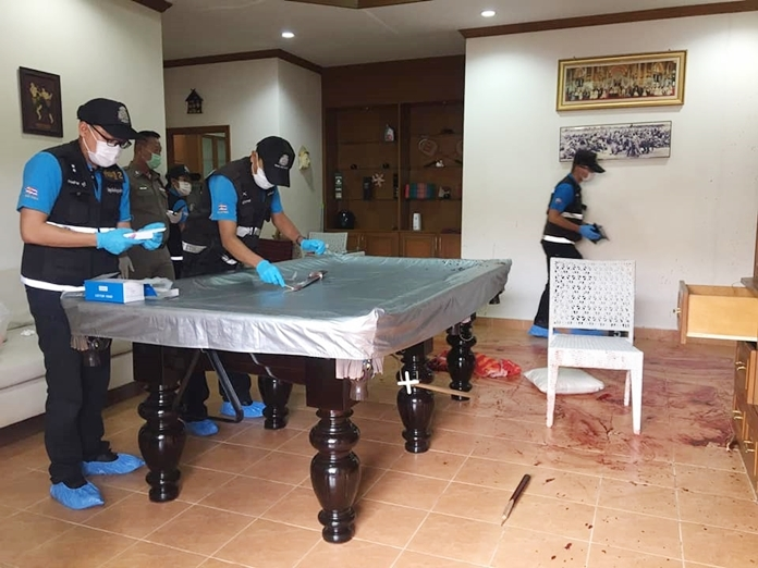 A bloody, broken pool cue and 60-centimeter knife were recovered on the floor and next to the pool table.