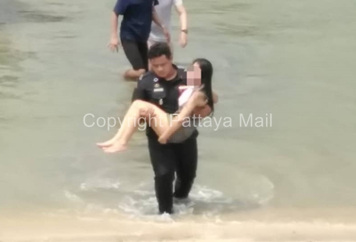 Pattaya security officers stop a woman from trying to drown herself.