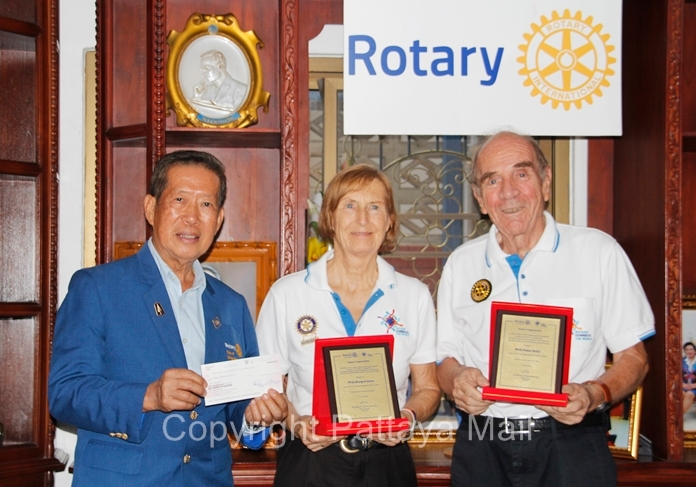 DG Maruay Jintabanditwong receives a cheque from Rotary E-Club of Dolphin Pattaya International, presented by Rotary 3340 Past Presidents Dr. Margret and Dr. Otmar Deter.