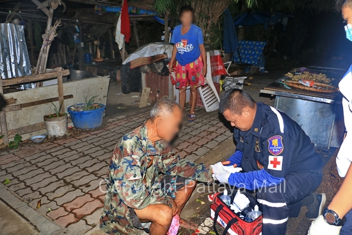 Rescue workers tend to Supapol Wisedwongsa before sending him to Queen Sirikit Naval Medical Center.