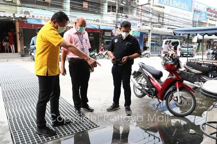 Deputy Mayor Banlue Kullavanijaya is shown where sewage follows out of unconnected pipes.