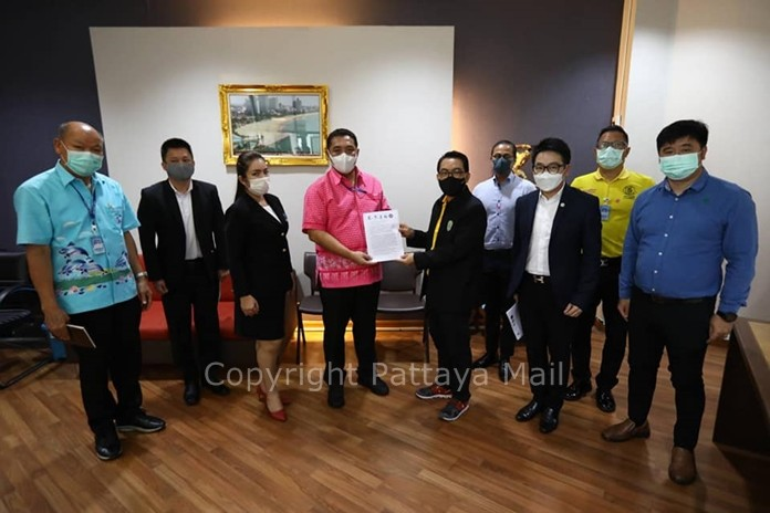 Pattaya business owners, led by the Chonburi Tourism Council, present a letter to Mayor Sonthaya Kunplome for an extension of relief measures for the tourism industry.