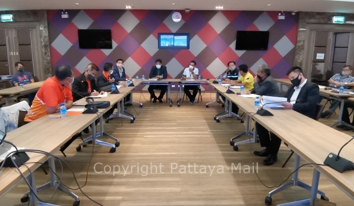 The Provincial Electricity Authority meets with local officials to explain how the project to modernize the Pattaya's power grid has run smack into the city's ancient remnants as it digs up Waking Street.