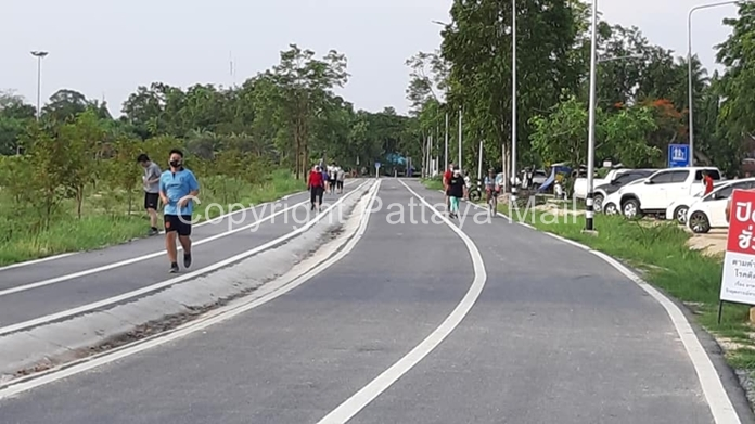 Joggers and cyclists on the exercise path around Mabprachan Lake are a sight for sore eyes.