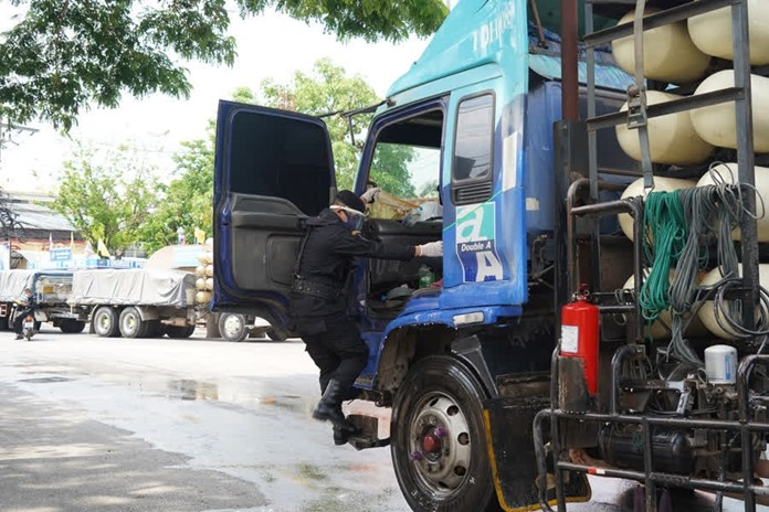 Every cargo truck entering the country from Cambodia go through disinfection process at Ban Klong Luk border crossing.