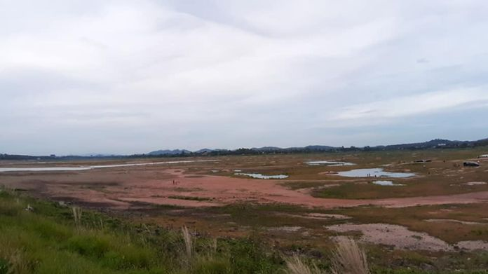 Mapprachan reservoir, one of the main rain reserves supplying water into the taps of the residences in Pattaya City and Nongprue sub-district area on Sunday May 17 is seen totally dried up as the rainy season kicks in.