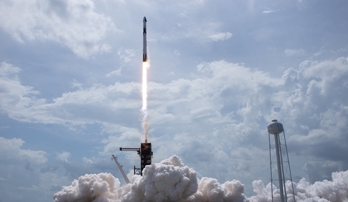 A SpaceX Falcon 9 rocket carrying the company's Crew Dragon spacecraft launches from Launch Complex 39A on NASA's SpaceX Demo-2 mission to the International Space Station with NASA astronauts Robert Behnken and Douglas Hurley onboard, Saturday, May 30, 2020, at NASA's Kennedy Space Center in Florida.