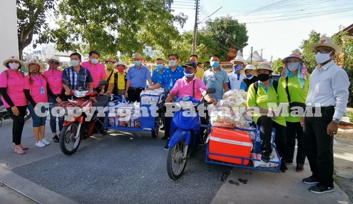 The City Hall entourage poses beside their motorbike-sidecars laden with food packages that were distributed to the Nongyai communities.
