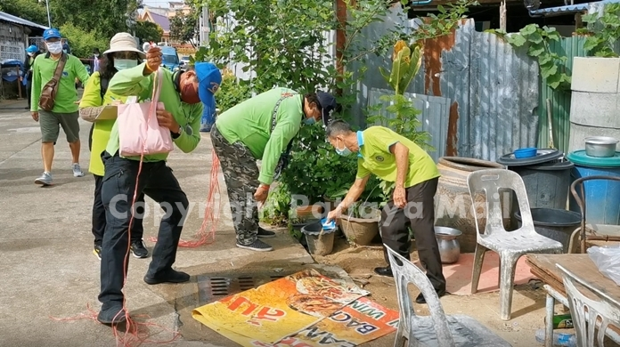 SSR teams pour abate into drains to reduce the spread of common house mosquitoes.