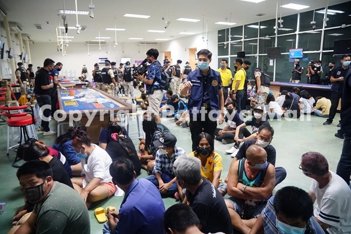 Interior Ministry officials seized 700,000 baht and arrested 118 people during a raid at a Rayong underground casino.