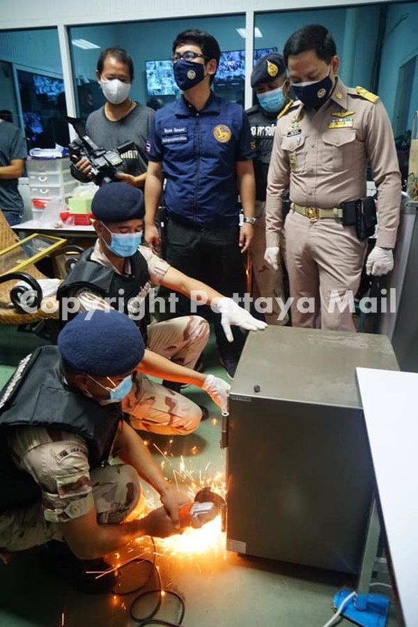 Special investigation officers hack into a safe to retrieve the gambling money.