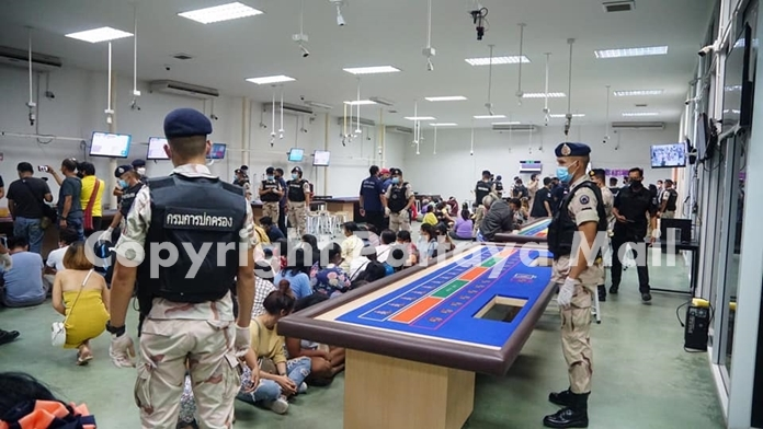 Inside the 600-sq.-meter facility were more than 100 people with card tables and slot machines.