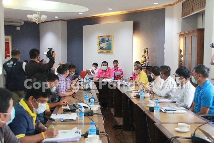 Mayor Sonthaya Kunplome meets with representatives from the Provincial Electricity Authority, Provincial Waterworks Authority and CAT Telecom to discuss the project to lay new electrical systems and bury overhead power and communications wires.