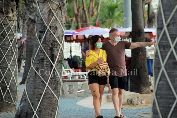 Foreigners are happy the beaches are open so they will have place to watch the sunset with their girl.