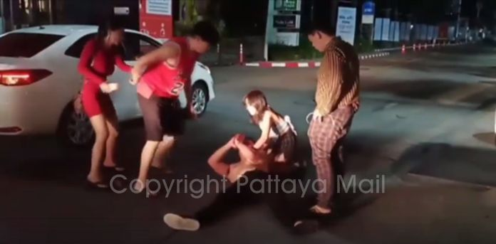 A drunk Chinese expat was arrested after smashing a police vehicle when his girlfriend left him.