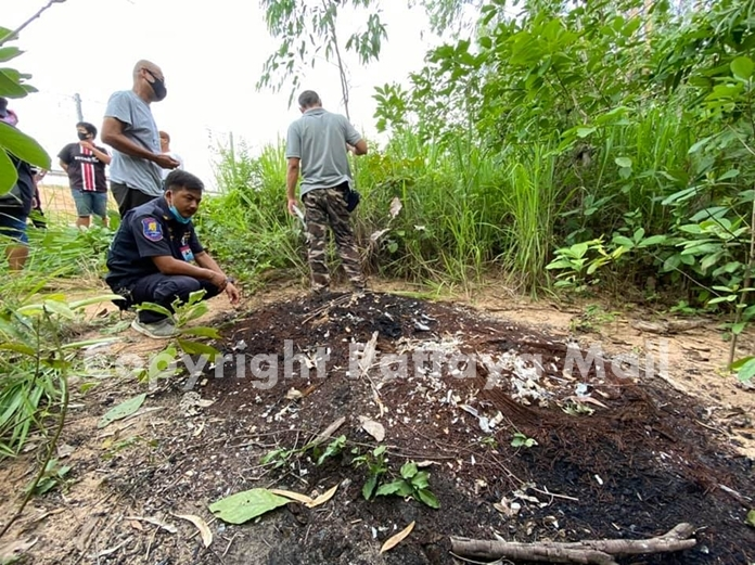 Police are trying to identify the charred remains of a person found in the ashes of three burnt tires in a eucalyptus field outside Pattaya.