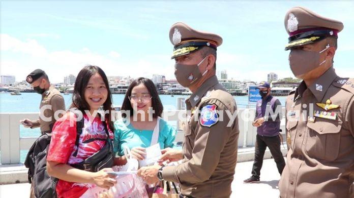 Pol. Lt. Gen. Chetta Komolwattana mingle with tourists on Bali Hai pier.