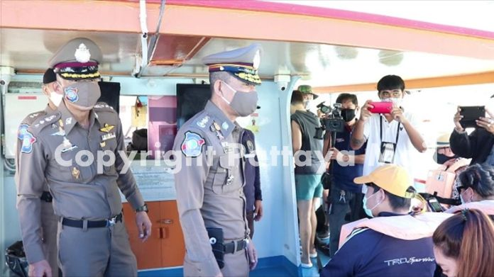 Tourist Police greet tourists on the boat to Koh Larn.