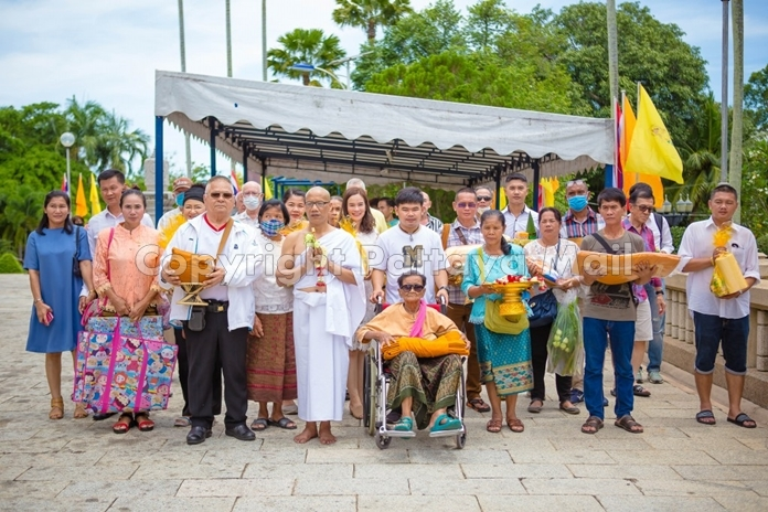 Family and friends gather to congratulate Wat on entering the monkhood.