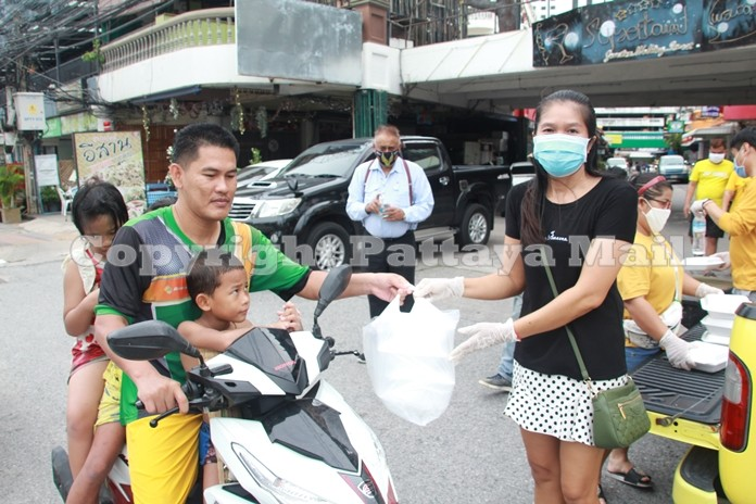 Miss Jo gives packages of food to this man and his family.