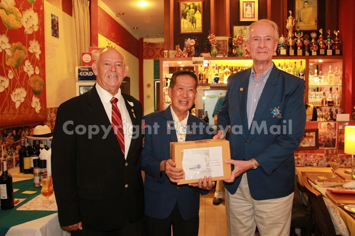 Pres. Dieter Reigber of the Rotary Club Eastern Seaboard receives his allotment of face masks from DG Maruai Jintabunditwong.