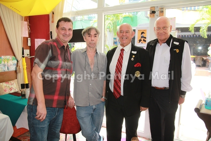 Pres. Eric Larbouillat and Alain Large from the Rotary Club Pattaya Marina, enjoy the proceedings with Rodney Charman and Jan Abbink from the Rotary Club Eastern Seaboard.