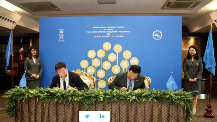 Mr. Renaud Meyer, the UNDP Resident Representative in Thailand and Mr. Yuthasak Supasorn, TAT Governor.