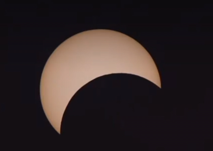 The partial eclipse seen in Bangkok and other parts of Thailand started at about 1 p.m. and continued until 4.10 p.m.with varying degrees of the sun appearing covered.
