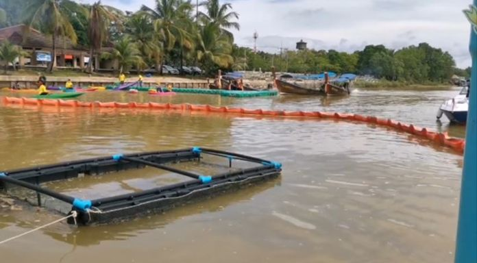 Trash booms were installed in the Tapi River to contain floating trash and debris before reaching the ocean.