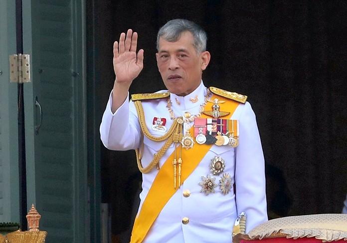 King Maha Vajiralongkorn Bodindradebayavarangkun greets an audience from the balcony of Suddhaisavarya Prasad Hall in the Grand Palace Monday, May 6, 2019, in Bangkok.