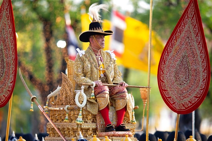 King Maha Vajiralongkorn Bodindradebayavarangkun is carried on a palanquin through the streets outside the Grand Palace for the public to pay homage during the second day of his coronation ceremony in Bangkok, Sunday, May 5, 2019.