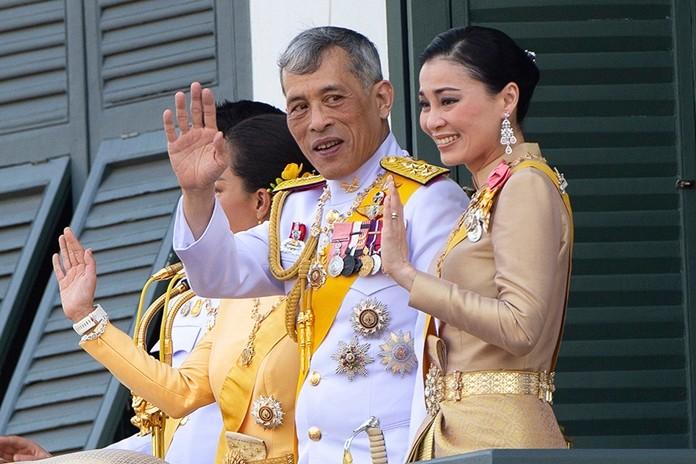 King Maha Vajiralongkorn Bodindradebayavarangkun and Queen Suthida wave to an audience from the balcony of Suddhaisavarya Prasad Hall in the Grand Palace during the coronation ceremony Monday, May 6, 2019, in Bangkok.