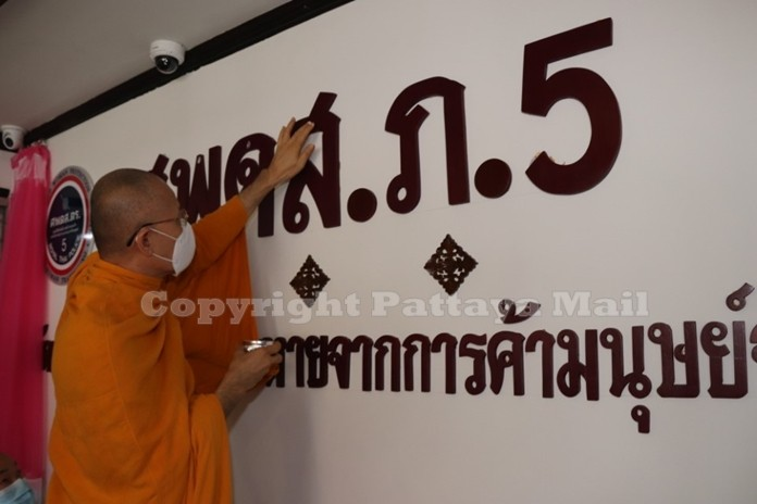 A monk anoints the Center on Identifying and Caring for Trafficking Victims signboard at Provincial Police Region 5.