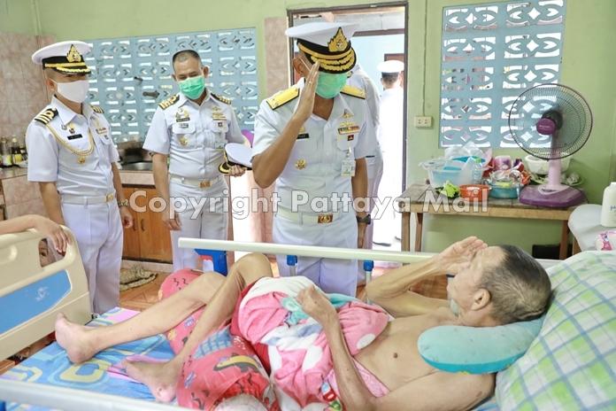 Rear Adm. Utai Chewasutti, commander of the Sattahip-based Air and Coastal Defense Command visits retired sailor Prasert Lim, 75.