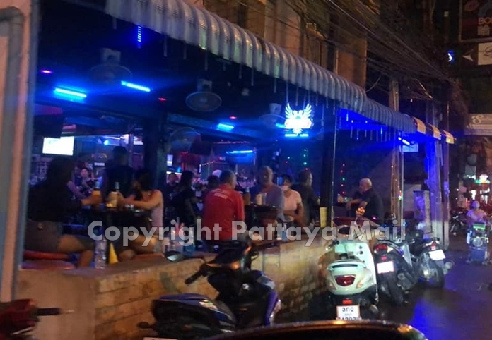 Police (not shown) made their presence felt in the rain on Walking Street, checking the few bars that were open to make sure they were collecting customer information to facilitate contact tracing.