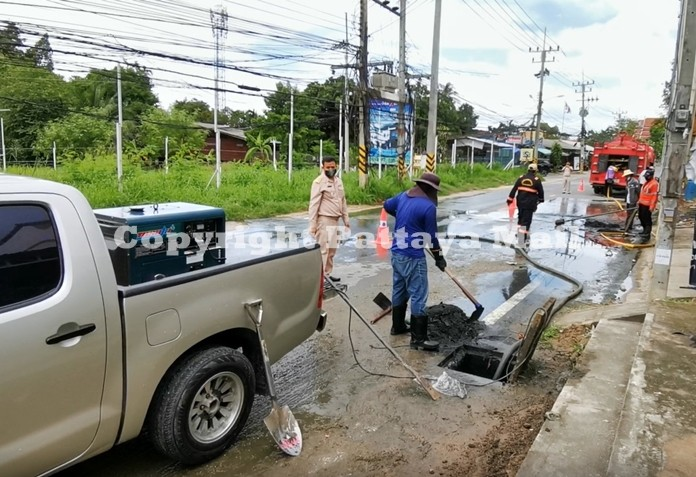 Sanitary Engineering Division of Nong Plalai Municipality workers dredge the canals along the city streets to prevent flooding during the rainy season.