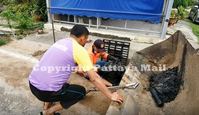 Workers had to literally crawl into the sewers and manually dig out the muck and filth clogging the drains.