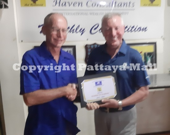Brian Chapman (right) presents the trophy to Auke Engelkes, annual winner for the second straight year.