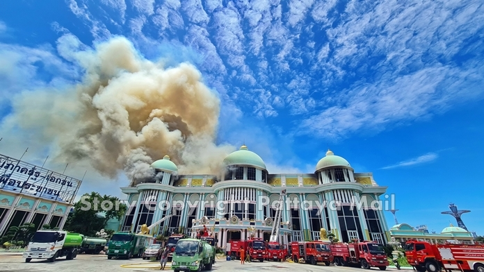 Fire destroyed major sections of Pattaya tourist attraction Sukhawadee House on Wednesday.