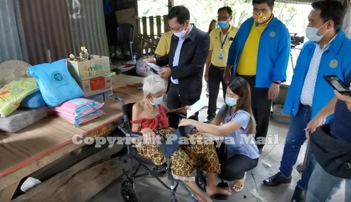 A nurse secures grandma Sopin in her wheelchair.
