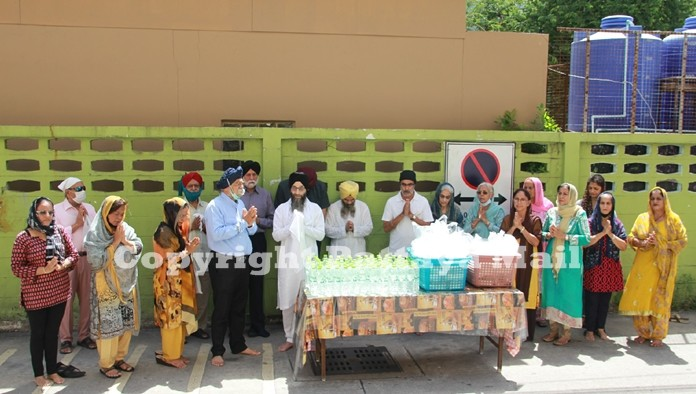 The Sikh congregation joins in prayer before handing out food to the needy in the community.