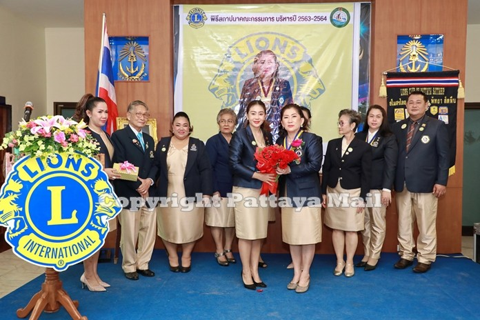 Lions club members congratulate Wipada Katacharoen, the newly installed president of the Lions Club of Pattaya- Sattahip.